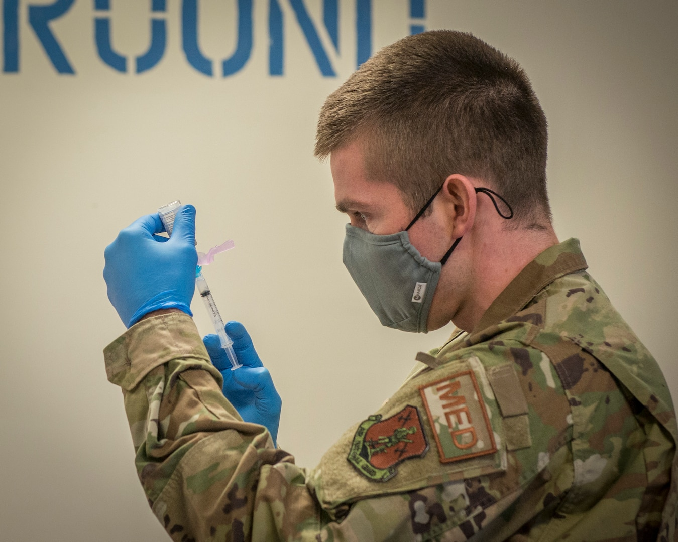 U.S. Air Force Capt. Greg Flis, 103rd Medical Group nurse practitioner, draws Moderna COVID-19 vaccine from a vial into a syringe at Bradley Air National Guard Base in East Granby, Connecticut, Dec. 30, 2020. The Connecticut National Guard began administering the vaccine in accordance with the Department of Defense COVID-19 vaccine distribution plan, with doses voluntarily administered to Soldiers and Airmen on the front lines of the COVID-19 pandemic response.