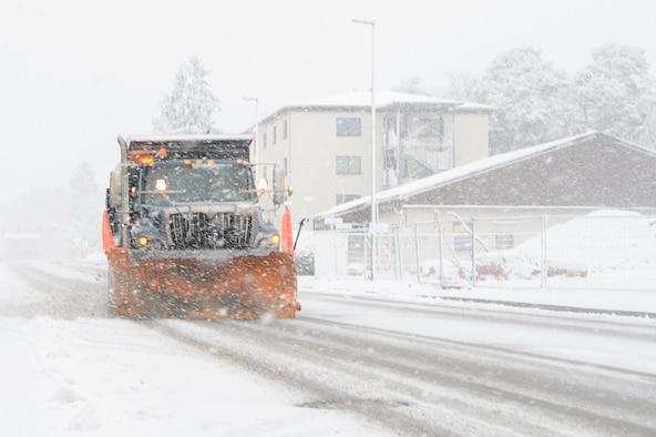 A dump truck removes snow.