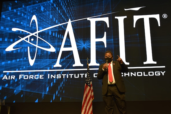 Dr. Adedeji Badiru, dean of the Air Force Institute of Technology's Graduate School of Engineering and Management, presents the school's annual awards honoring faculty and staff for outstanding performance on Jan. 22