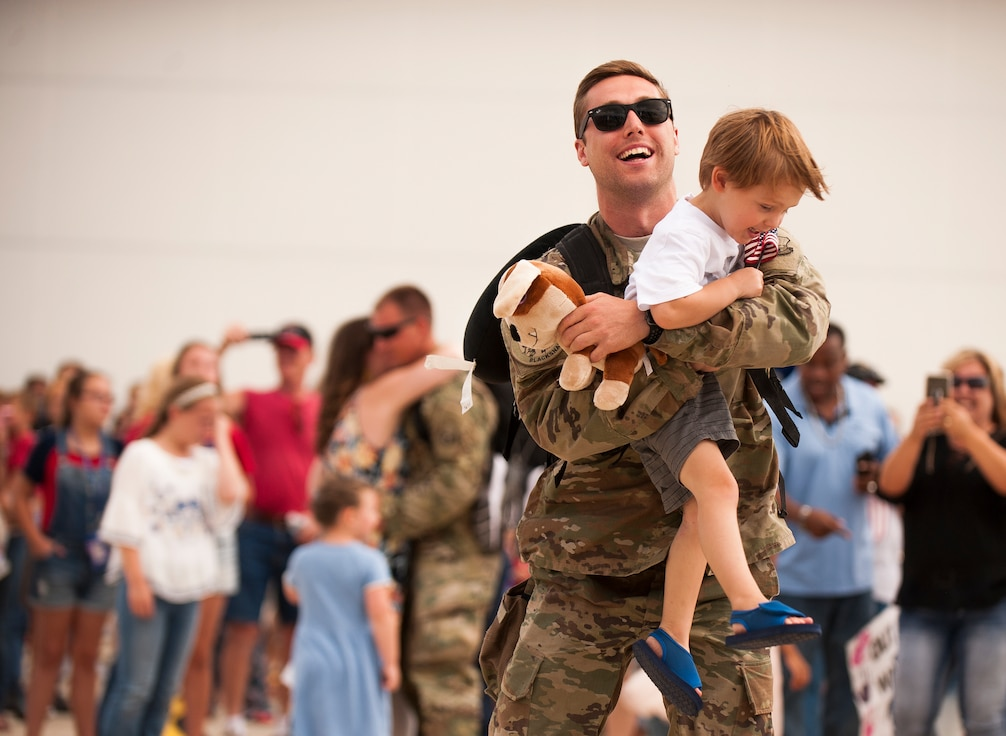 U.S. Airmen with the Indiana Air National Guard return home to waiting family and loved ones July 27, 2018, at the 122nd Fighter Wing, Fort Wayne, Indiana. The Blacksnakes deployed approximately 300 Airmen along with their squadron of A-10C Thunderbolt II aircraft to Afghanistan for over three months in support of Operation Freedom's Sentinel. (U.S. Air National Guard photo by Tech. Sgt. William Hopper)