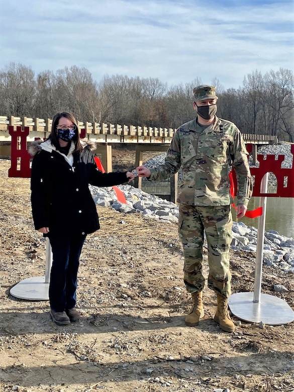 IN THE PHOTO, Memphis District Commander Col. Zachary Miller coins Project Manager Amber Jarnagin for her excellent performance in executing this project.  (USACE photos by Jessica Haas)