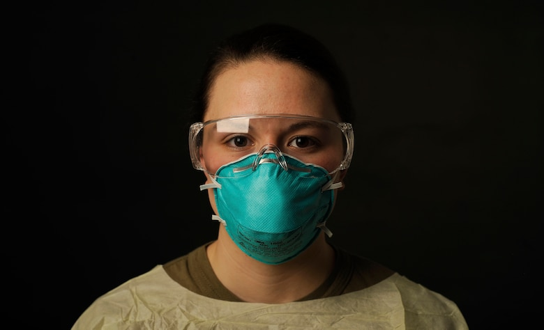 U.S. Air Force Senior Airman Toula Farnsworth, a 354th Operational Medical Readiness Squadron medical technician, poses for a photo in COVID-19 proper protective equipment on Eielson Air Force Base, Alaska, Jan. 19, 2021. Farnsworth is responsible for administering the COVID-19 test and ensuring the test is accurate by preventing cross-contamination. (U.S. Air Force photo by Senior Airman Beaux Hebert)