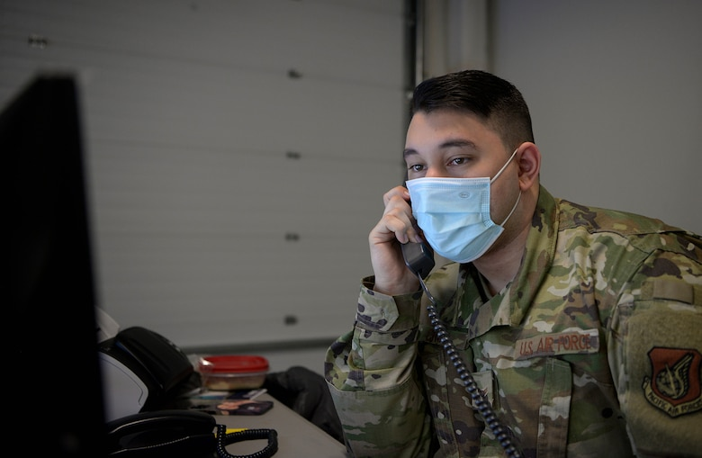 U.S. Air Force Airman 1st Class Giovanni Cruz, 354th Healthcare Operations Squadron health service management specialist, answers a phone call from a patient Jan. 13, 2021 on Eielson Air Force Base, Alaska.. Cruz records COVID-19 tests, logs them into the patient's medical history and works with the 354th Operational Medical Readiness Squadron Public Health Flight to mitigate the spread of the virus. (U.S. Air Force photo by Senior Airman Beaux Hebert)