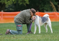Photo of Kimberly Appel embracing Kitara after a competition event.