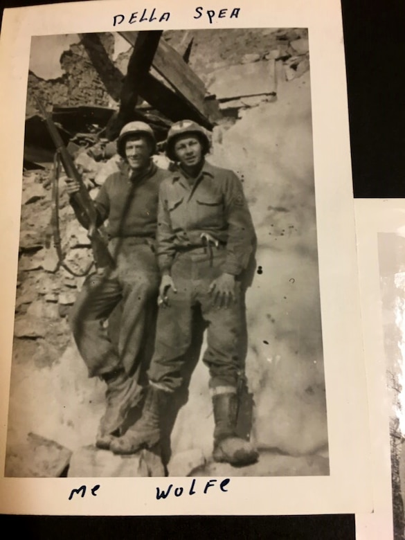 Two soldiers standing on rocks