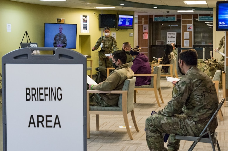 Team Dover front-line workers watch an informational video about the COVID-19 vaccination Jan. 22, 2021, at Dover Air Force Base, Delaware. Team Dover front-line workers voluntarily received the vaccine in accordance with Department of Defense guidance. (U.S. Air Force photo by Roland Balik)