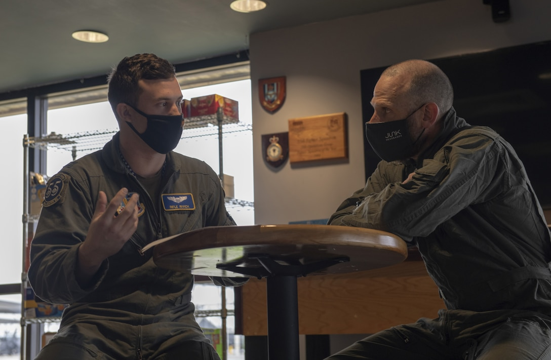Photo of Air Force pilot giving brief