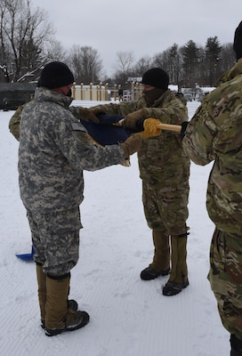Col. Brey Hopkins (left) and Lt. Col. Matthew Wignall case the colors of the 3rd Battalion, 172nd Infantry during a sendoff ceremony at the Camp Ethan Allen Training Site parade field Jan. 29, 2021, in Jericho, Vermont. The 3-172nd, part of the Vermont National Guard's 86th Infantry Brigade Combat Team (Mountain), will operate as Task Force Avalanche during a year-long deployment to the U.S. Central Command area of responsibility. (U.S. Army National Guard photo by Don Branum)