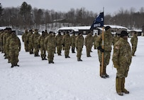 Soldiers with Headquarters Company, 3rd Battalion, 172nd Infantry, stand at attention during a sendoff ceremony Jan. 29, 2021, at the Camp Ethan Allen Training Site parade field in Jericho, Vermont. The 3-172nd, part of the Vermont National Guard's 86th Infantry Brigade Combat Team (Mountain), will deploy to the U.S. Central Command area of operations for about a year starting in February. (U.S. Army National Guard photo by Don Branum)