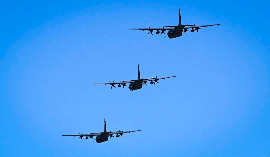 Three aircraft flying in the air.
