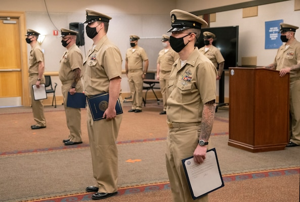Chief Petty Officer selects Matthew Bernstein, Devin Donohue, Austin Rhodes and Mark Robbins, with Puget Sound Naval Shipyard & Intermediate Maintenance Facility, were pinned to the rank of chief petty officer during a ceremony Jan. 29, 2021, at Olympic Lodge on Naval Base Kitsap-Bremerton, Washington. The ceremony had limited attendees, with participants and attendees socially distanced to adhere to COVID-19 protective protocols.