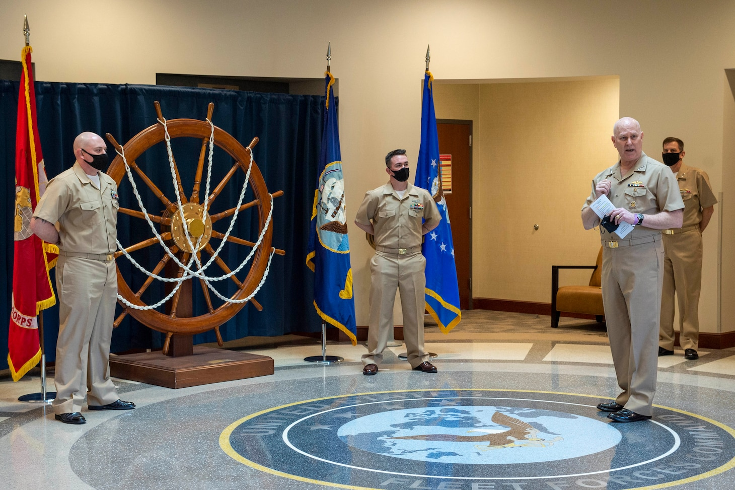 Adm. Christopher W. Grady, commander, U.S. Fleet Forces Command presides over the pinning of Chief Intelligence Specialist Joshua Waldrop and Chief Aviation Aerographer's Mate Travis Strait during a chief petty officer (CPO) pinning ceremony at the USFFC headquarters in Norfolk, Virginia.