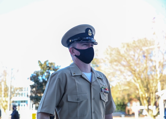 hief Aviation Aerographer's Mate Travis Strait, assigned to U.S. Fleet Forces Command (USFFC), stands at the position of attention after his advancement during a chief petty officer (CPO) pinning ceremony at the USFFC headquarters in Norfolk, Virginia.