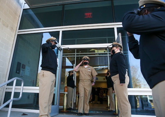 Chief Intelligence Specialist Joshua Waldrop, assigned to U.S. Fleet Forces Command (USFFC), renders a hand salute after his advancement during a chief petty officer (CPO) pinning ceremony at the USFFC headquarters in Norfolk, Virginia.
