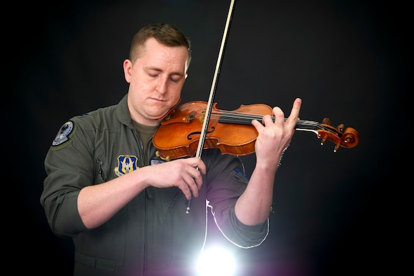 Capt. Rob Reilly, 434th Air Refueling KC-135 Stratotanker pilot, conducts a violin performance during a demonstration at Grissom Air Reserve Base, Indiana, Jan. 29, 2021. In addition to being a tanker pilot, Reilly sits as a first chair violinist with the Indinapolis Philharmonic Orchestra. (U.S. Air Force photo/Master Sgt. Benjamin Mota)