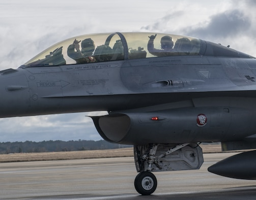 Photo of an F-16 pilot with passenger