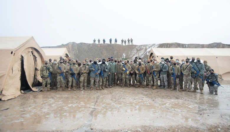 A large group of Airmen pose for a group photo.