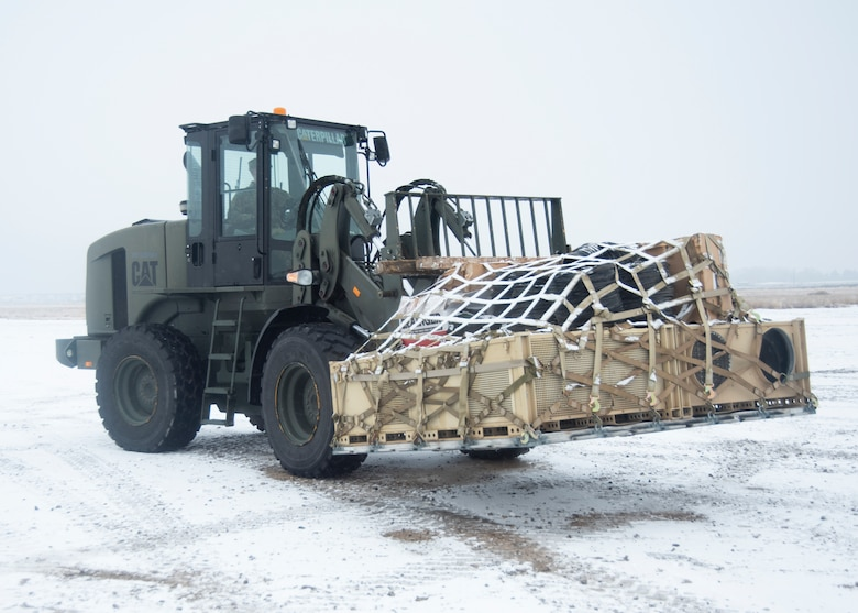 A picture of a forklift vehicle picking up an aircraft pallet.