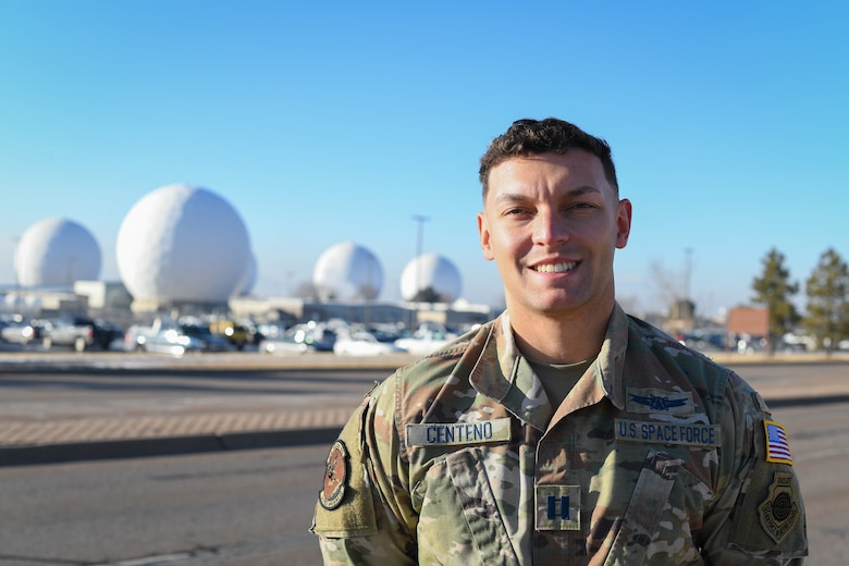U.S. Space Force Capt. Angelo Centeno, 2nd Space Warning Squadron weapons and tactics flight commander, poses for a picture in front of the Radomes at Buckley Air Force Base, Colo., Jan. 27, 2021.