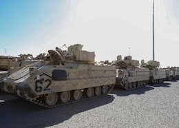 Humvees, M2 Bradley Fighting Vehicles and other vehicles are staged for transfer at the Port of Shuaiba for the upcoming Iron Union exercise Jan. 21, 2020 at the Port of Shuaiba, Kuwait. The recurring, bilateral exercise between the U.S. and the United Arab Emirates strengthens relationships and increases interoperability between the two nation's military forces. (U.S. Army photo by Spc. Zoran Raduka, 1st TSC Public Affairs)