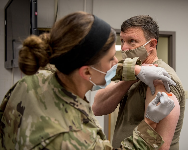 Brig. Gen. Jeffrey L. Wilkinson (right), Kentucky's assistant adjutant general for Air, is administered a COVID-19 vaccination by Master Sgt. Natasha Perry, a medic with the 123rd Medical Group, at the Kentucky Air National Guard Base in Louisville Ky., Jan. 9, 2021. (U.S. Air National Guard photo by Staff Sgt. Joshua Horton)