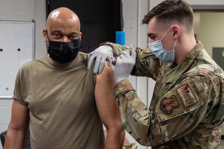 Brig. Gen. Charles Walker (left), chief of staff for Joint Forces Headquarters Kentucky — Air, receives his first COVID-19 vaccination at the Kentucky Air National Guard Base in Louisville, Ky., Jan. 10, 2021. All Kentucky Air Guard members are eligible for the vaccinations. (U.S. Air National Guard photo by Lt. Col. Allison Stephens)