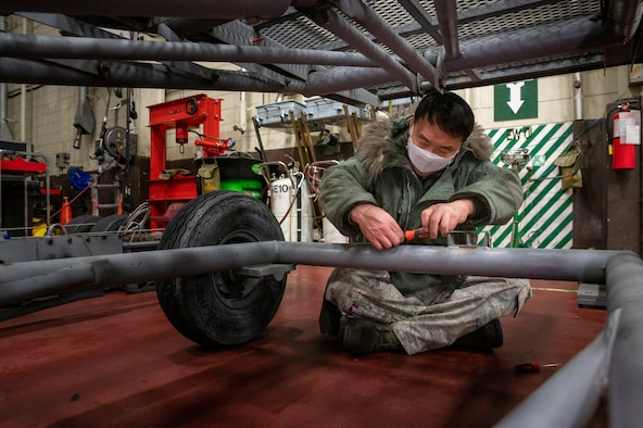 Kwang Yol Pak, 51st Maintenance Squadron aerospace ground equipment mechanic, repairs a moveable staircase at Osan Air Base, Republic of Korea, Jan. 21, 2021. Korean civilian Airmen work alongside U.S. Airmen to ensures each piece of equipment they inspect and repair meets the proper standards before it can be sent back out to the flightline for use. (U.S. Air Force photo by Senior Airman Branden Rae)