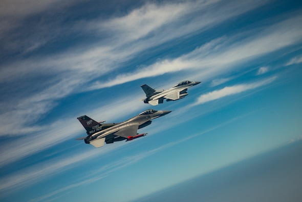 Two jets fly together.