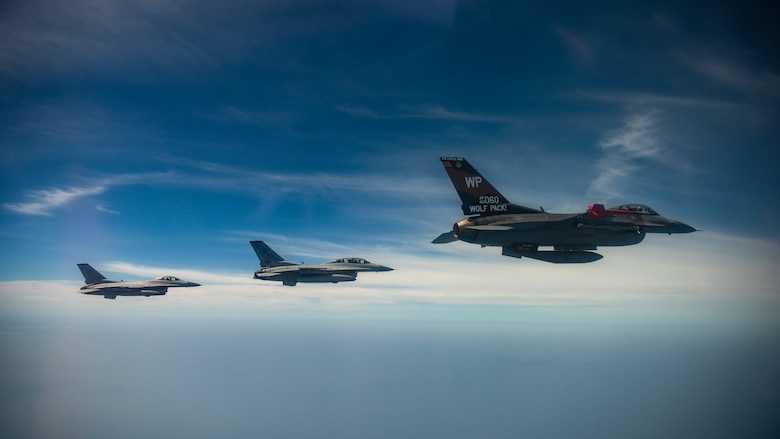 Jets fly in the sky together.