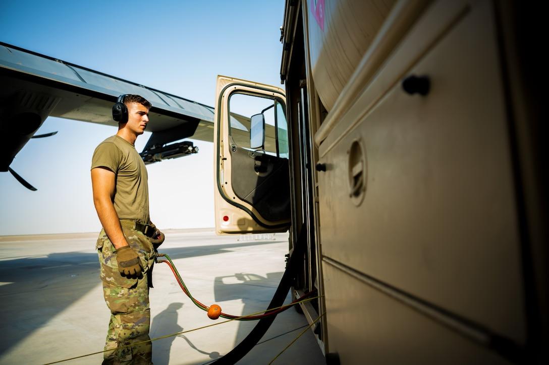 U.S. Air Force Senior Airman Robert Waldbillig, 380th Expeditionary Logistics Readiness Squadron fuels distributor,  fuels aircraft at Al Dhafra Air Base, United Arab Emirates, June 23, 2021.