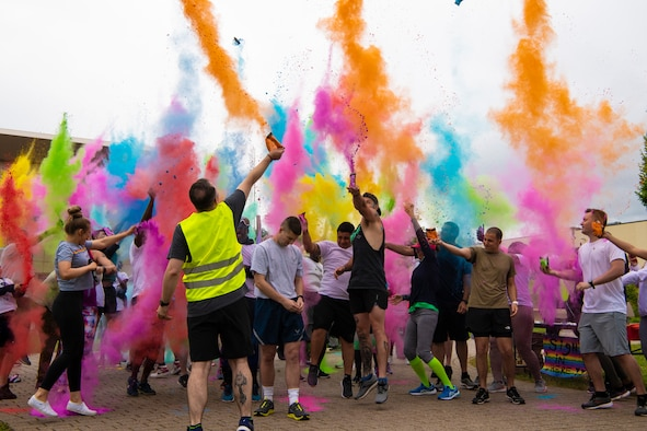 U.S. Air Force Staff Sgt. Nathan Baker, 52nd Force Support Squadron Airman Leadership School instructor, participates in a Pride color run, June 30, 2021, on Spangdahlem Air Base, Germany. Pride Month is celebrated every year to recognize and honor the Stonewall riots in 1969, a pivotal time for the lesbian, gay, bisexual, transgender, and queer community  in their fight for equality as United States citizens. (U.S. Air Force photo by Staff Sgt. Melody W. Howley)