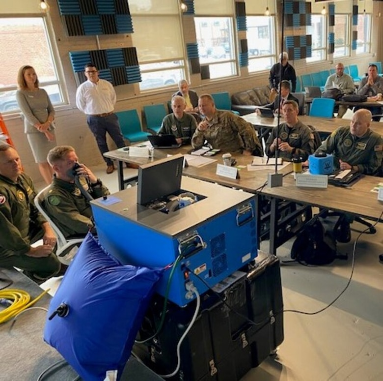 """Air Force and Navy officials watch a demonstration during the inaugural Physiological Episodes Mitigation Technology Summit and Industry Day in Dayton, Ohio, Dec. 17-18. (U.S. Air Force photo/Lt. Col. Christianne """"BOS"""" Opresko)"""
