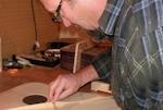 Man building a guitar