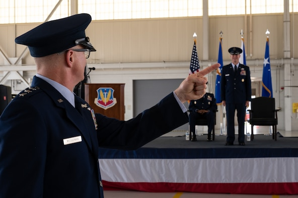 Deputy commander of Air Combat Command, renders the first salute to Gen. Mark Kelly, the new commander of ACC, during change of command ceremony