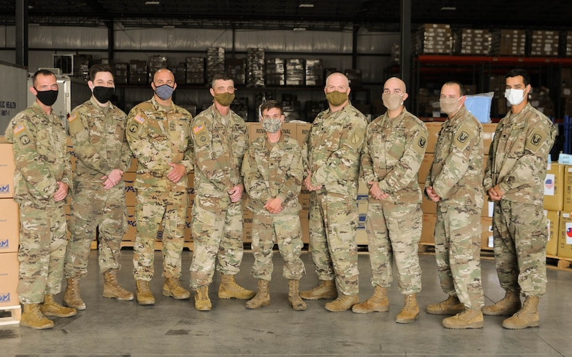 Kentucky Army National Guard troops pause for a photo at the supply warehouse in Frankfort, Ky., Sept. 10, 2020.