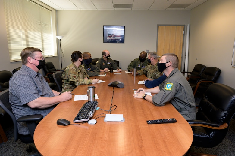 U.S. Airmen, Department of Defense civilians, and contractors with the 116th Air Control Wing plans and programs (XP) office, Georgia Air National Guard, and 461st ACW XP office, hold a staff meeting at Robins Air Force Base, Georgia, May 13, 2021.