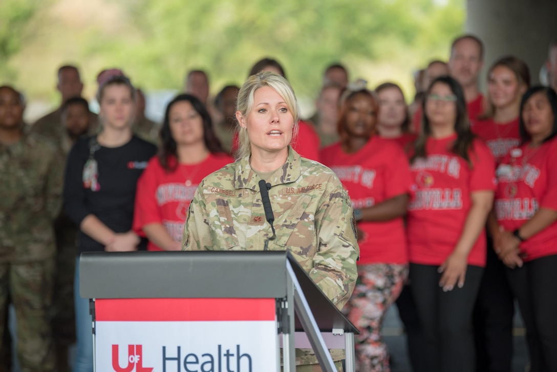 Maj. Tiffany Campbell, officer-in-charge of a Kentucky National Guard team that has supported a drive-thru COVID testing and vaccination site for 15 months, speaks during a ceremony to mark its closure in downtown Louisville, Kentucky, on June 30, 2021. The Guard has assisted medical staff from the University of Louisville with 17,160 COVID tests and the vaccination of more than 145,230 citizens. (U.S. Air National Guard photo by Phil Speck)