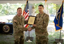 Incoming Product Manager Soldier Precision Targeting Devices, Lt. Col. Aaron Pearsall receives the Product Manager Soldier Precision Targeting Devices Charter from Col. Copeland., during a Change of Charter ceremony held at Fort Belvoir, VA.