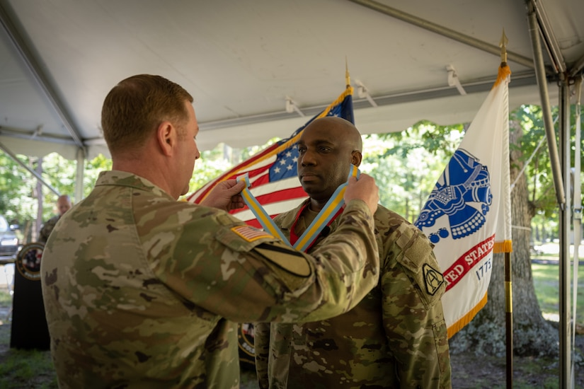 Outgoing Product Manager Soldier Precision Targeting Devices, Lt. Col. Jamal Williams receives awards and going away gifts during a Change of Charter ceremony held in Fort Belvoir, VA.
