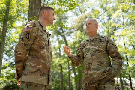 Incoming Product Manager Soldier Precision Targeting Devices, Lt. Col. Aaron Pearsall speaks with Maj. Gen. Tony Potts, PEO Soldier, during a Change of Charter ceremony held at Fort Belvoir, VA.