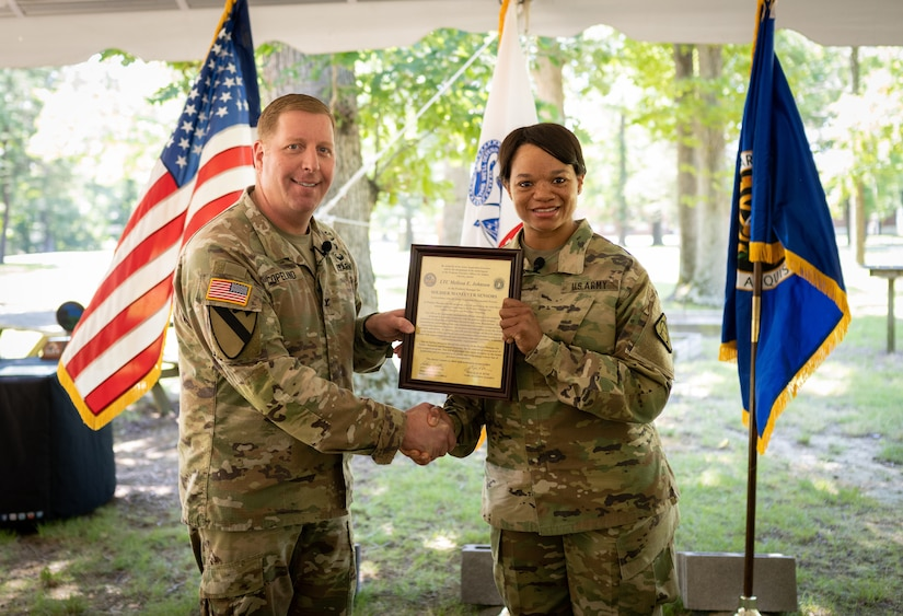 Lt. Col. Melissa Johnson receives the Product Manager Soldier Maneuver Sensor Charter from Col. Copeland.