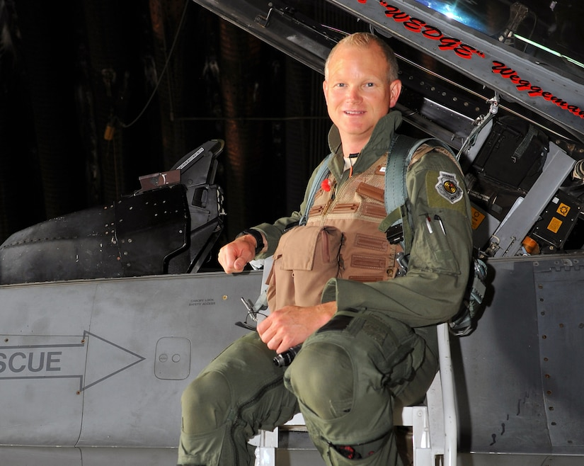 Brig. Gen. Chris Weggeman,boards an F-16 Fighting Falcon before his final flight