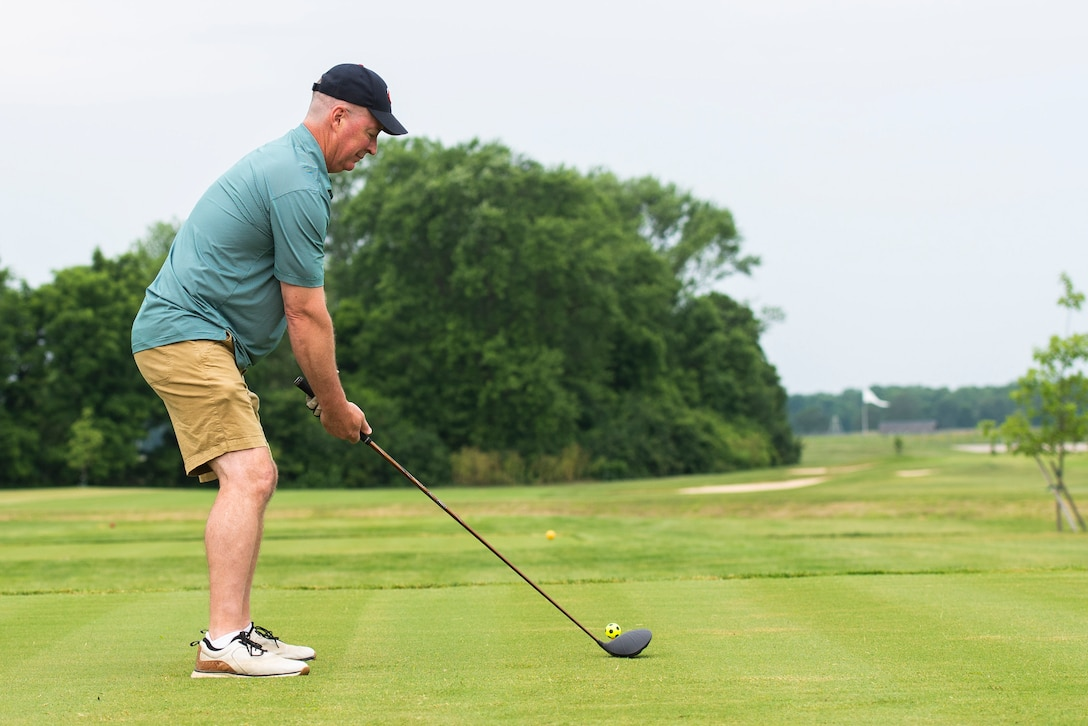 U.S. Air Force Brig. Gen. Brian Bruckbauer, Air Force Security Assistance Center commander, tees up for the first shot on the newly designed holes 7 of the Prairie Trace golf course, June 25, 2021, at Wright-Patterson Air Force Base, Ohio. The cutting marks the completion of the first phase of a multi-mission dollar program which required the previous holes to be moved to make room for the expansion of the National Air and Space Intelligence Center. (U.S. Air Force photo by Wesley Farnsworth)