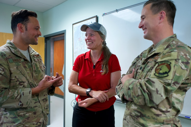 Alaska Air National Guardsmen of 210th Rescue Squadron, Tech. Sgt. Anthony Guedea (left) and Lt. Col. Michael Jordan meet with Iditarod musher Aliy Zirkle June 28, 2021, at Joint Base Elmendorf-Richardson, Alaska. Guedea and Jordan were part of the team that rescued Zirkle March 9 at the Iditarod Rohn checkpoint after she suffered a head injury.