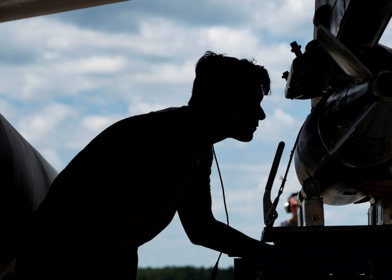 Photo of U.S. Airmen working on jet.