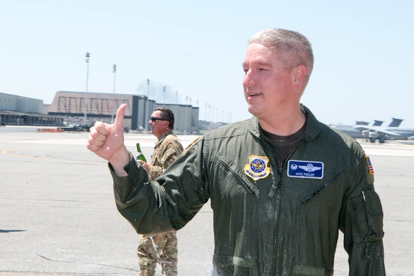 Col. Mike Peeler, 436th Operations Group commander, greets a crowd of friends and coworkers following his final flight as group commander at Dover Air Force Base, Delaware, June 30, 2021. Peeler served as commander for two years. (U.S. Air Force photo by Mauricio Campino)