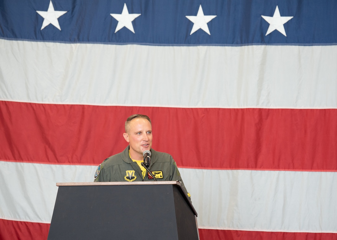 """Lt. Col. Greg Farrell gives a speech after taking command of the 4th Fighter Squadron, at Hill Air Force Base, Utah, on July 1, 2021. Farrell previously served as the director of operations for the 421st Fighter Squadron. The 4th FS, the """"Fighting Fuujins,"""" is one of three fighter squadrons that make up the 388th Operations Group, the other two squadrons are the 34th FS, the """"Rude Rams,"""" and the 421st FS, the """"Black Widows."""" (U.S. Air Force photo by Staff Sergeant Thomas Barley)"""