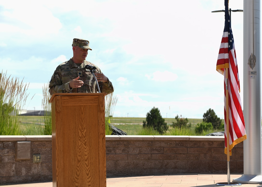 Lt. Col. Michael Mariner, 2nd Space Warning Squadron commander, addresses the crowd after the transferring of leadership during the 2 SWS change of command ceremony at Buckley Space Force Base, Colo., July 1, 2021. Mariner introduced himself and expressed his gratitude for his family and new team. (U.S Space Force photo by Airman 1st Class Haley N. Blevins)