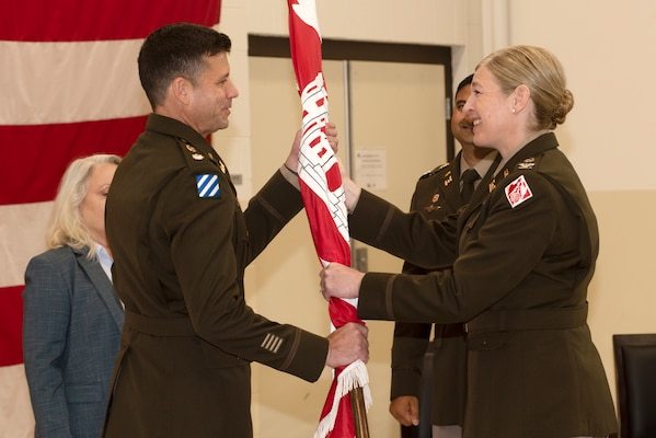 Col. Kimberly A. Peeples (Right), U.S. Army Corps of Engineers Great Lakes and Ohio River Division commander, passes the Nashville District flag to Lt. Col. Joe M. Sahl as he took command of the Nashville District during a change of command ceremony July 1, 2020 at the Tennessee National Guard Armory in Nashville, Tenn. (USACE photo by Lee Roberts)