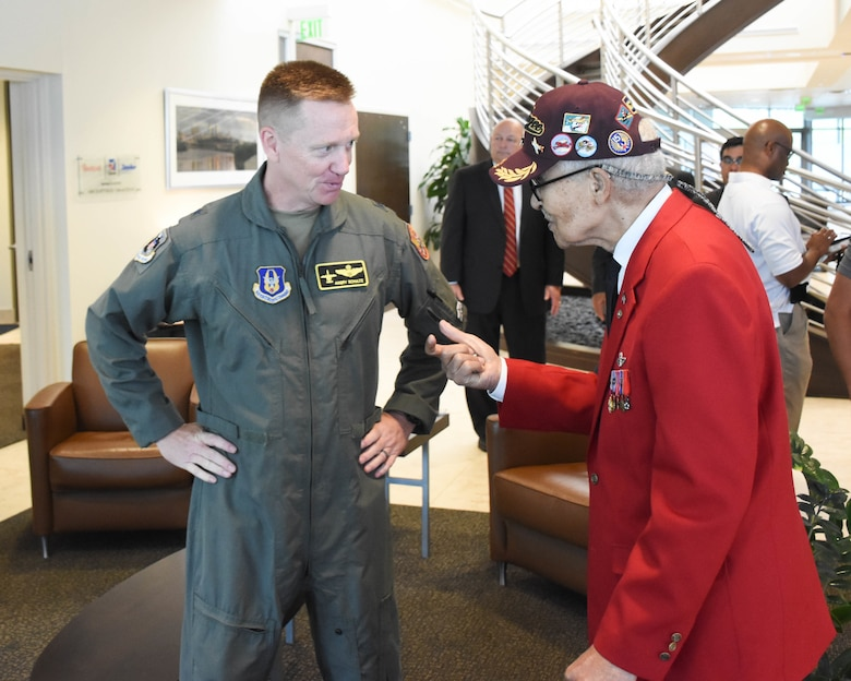 Brig. Gen. Mike Schultz, the 442d Fighter Wing commander, speaks with Tuskegee Airman retired Brig. Gen. Charles E. McGee
